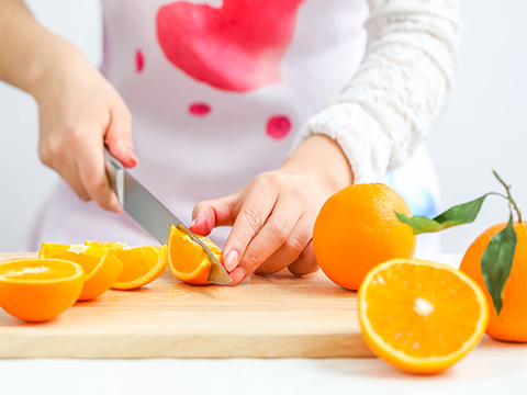 Clean, dry and cut oranges into chunks.