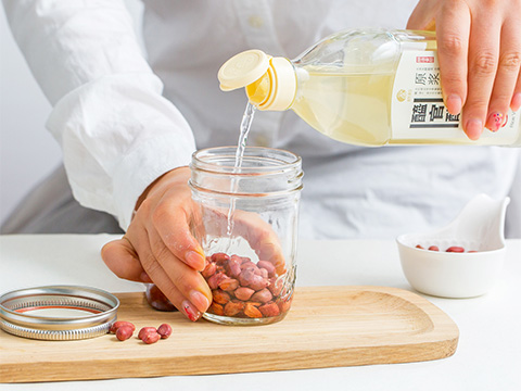 Place washed organic peanuts in a sanitised, air-tight jar; fill to the brim with XI GUAN CU Rice Vinegar.